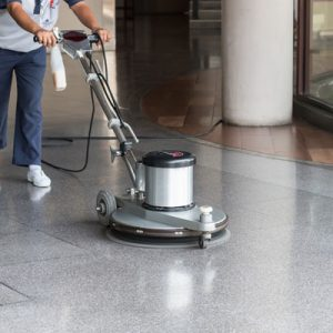floor cleaning Office cleaner using floor polishing and cleaning equipment
